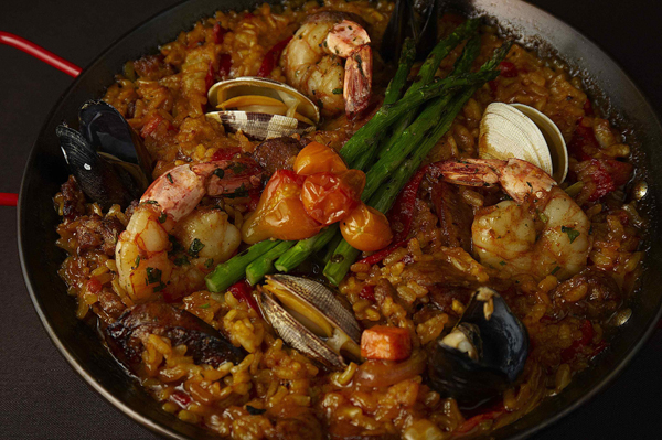 Paella made with whatever is seasonal and fresh seafood, house made sausage, chicken, piquillo, saffron rice, and harissa.
