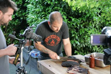 Campfire For You's Co-Owner and Master of Meats Stefan Giles meticulously slices brisket (Photo credit: Nathan Fish)