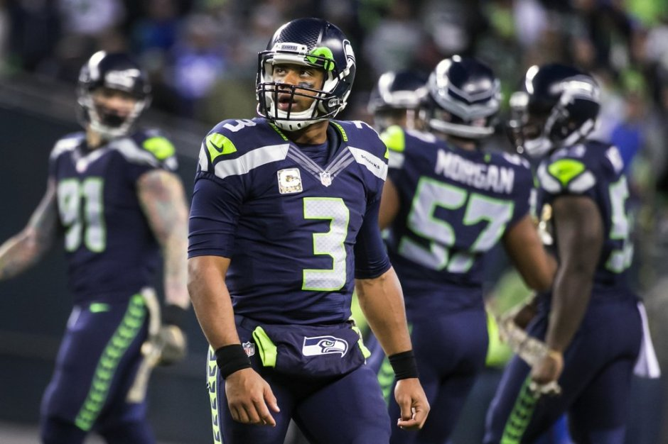 Seahawks quarterback Russell Wilson looks up at the replay after he threw an incomplete pass on third and 15 in the final six minutes as the Seattle Seahawks lost 39-32 to the Arizona Cardinals Sunday November 15, 2015 at CenturyLink Field in Seattle.